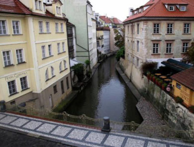 The Canal by Charles Bridge in Prague